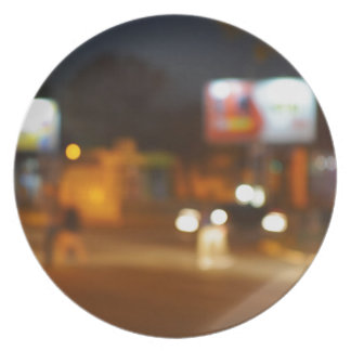 Abstract urban night scene with blurred headlights melamine plate
