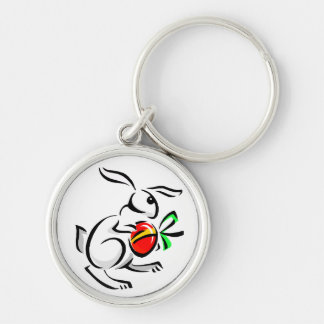 abstract white rabbit red egg hopping.png keychain