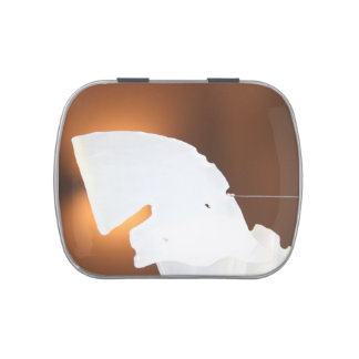 abstract white shape against brown candy tins