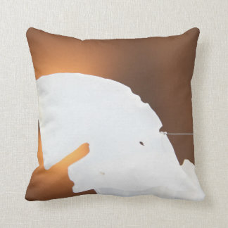 abstract white shape against brown pillow
