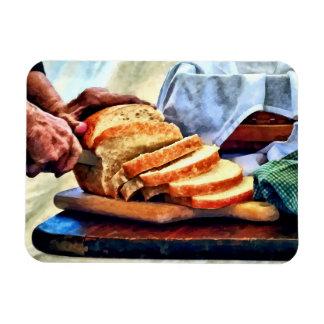 Abuela que corta el pan imanes flexibles