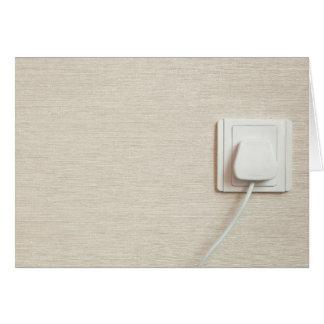 AC power plug in wall socket Card