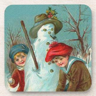 Acebo de la nieve de los niños del muñeco de nieve posavasos de bebida