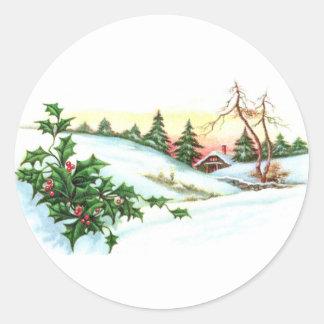 Acebo y una casa en el navidad del vintage de las pegatina redonda