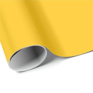 Acento ambarino amarillo de oro del color papel de regalo