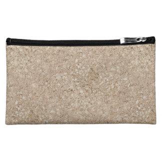 Acera beige amelocotonada pálida del cemento
