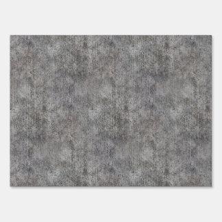 Acera gris resistida del cemento señales