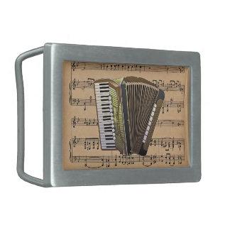 Acordeón con el fondo de la partitura hebillas cinturón rectangulares