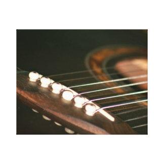 acoustic guitar bridge pins close up.jpg stretched canvas print