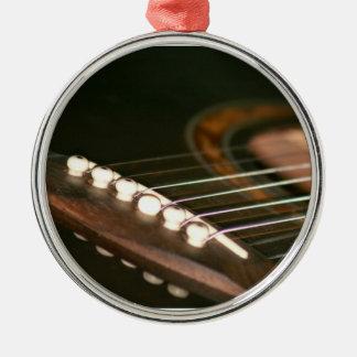 acoustic guitar bridge pins close up.jpg round metal christmas ornament