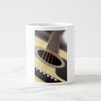 Acoustic guitar closeup photo large coffee mug