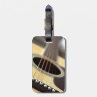 Acoustic guitar closeup photo tag for bags