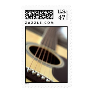 Acoustic guitar closeup photo postage