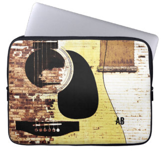 acoustic guitar on brick collage laptop sleeve