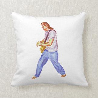 acoustic guitar player jeans feet apart pillow