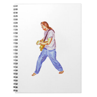 acoustic guitar player jeans feet apart spiral notebook