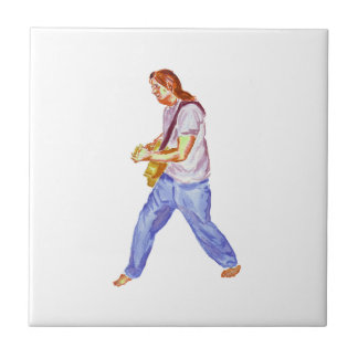 acoustic guitar player jeans feet apart tile