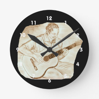 acoustic guitar player sitting sepia round clocks