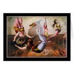 Acróbatas de sexo femenino del trapecio en el circ felicitaciones