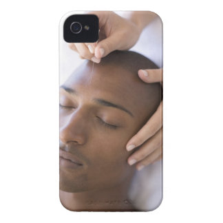 Acupuncture. Acupuncturist inserting a needle iPhone 4 Case