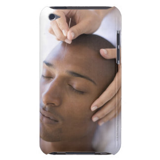 Acupuncture. Acupuncturist inserting a needle iPod Case-Mate Case