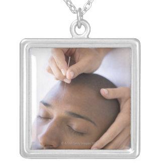 Acupuncture. Acupuncturist inserting a needle Square Pendant Necklace