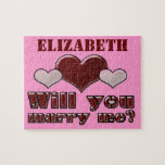 """Add Her Name Will You Marry Me Puzzle<br><div class=""""desc"""">Use this puzzle as a fun way to pop the big question!  Have her put the puzzle together to find your special message!  Personalize this puzzle with her name.  Makes a sweet keepsake she can keep to remember the special moment.</div>"""
