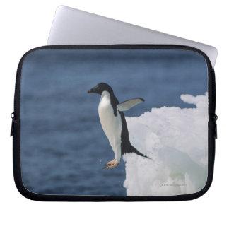 Adelie penguin leaping from iceberg laptop sleeve