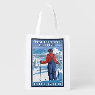 Admiración del esquiador - casa de campo del bolsas de la compra