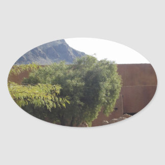 Adobe Building with Trees Oval Sticker