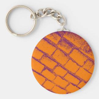 Adoquines púrpuras anaranjados llavero redondo tipo pin