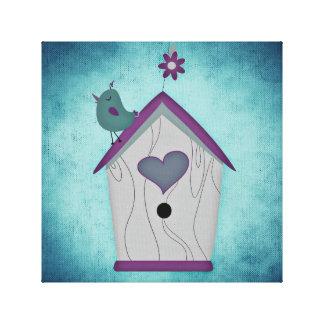 Adorable Blue and Purple Bird Atop a Birdhouse Canvas Print