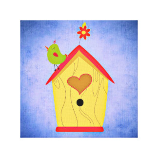 Adorable Green Bird on Red and Yellow Birdhouse Canvas Print