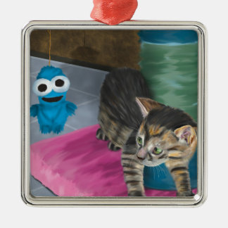 Adorable Grey Kitten Looking at a Blue Doll Metal Ornament