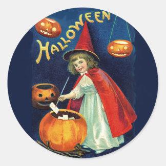 Adorable Halloween child witch and pumpkin sticker Round Sticker