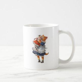 Adorable Kitty Cat Hugs Her Broken Doll. Coffee Mug