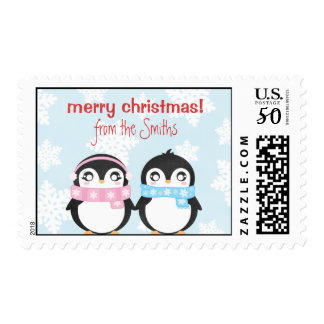 Adorable Penguin Couple with Snowflakes Postage