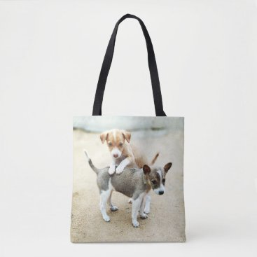 Adorable Puppies Playing on Beach Tote Bag