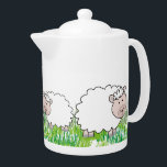 "Adorable Sheep Teapot<br><div class=""desc"">Sheep teapot.  Adorable sheep in the grass adorn this sweet little porcelain teapot.  A fun gift for anyone who loves farming and sheep.   Unique design and gift item for any occasion.</div>"