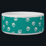 "Adorable Turquoise White Paw Print Large Dog Bowl<br><div class=""desc"">This large-sized dog bowl has a turquoise background with white paw prints on it.  Great size for larger dog varieties.  It holds 40 oz of food and is white ceramic material.  It is safe for the microwave and dishwasher as well.</div>"