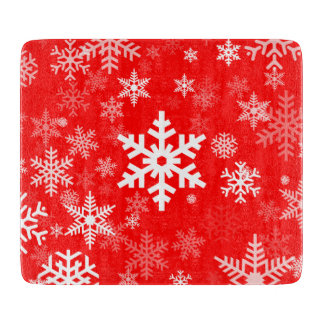 Adorno de los copos de nieve de los días de fiesta tablas para cortar