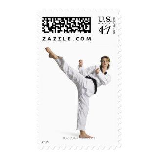 adult caucasian female martial arts expert in postage