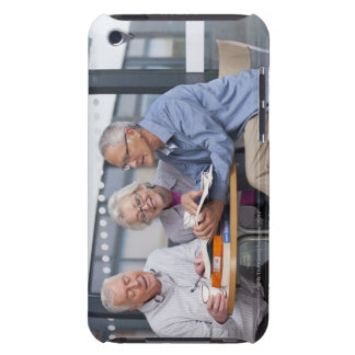 Adult students studying together in cafe barely there iPod covers