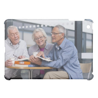 Adult students studying together in cafe iPad mini case