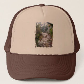 Adventure Awaits just over the Trail Trucker Hat