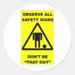 Advertencia de la muestra de seguridad etiqueta redonda