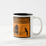 ¡Advertencia! Taza de café en curso del © de la ci
