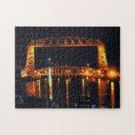 "Aerial Lift Bridge Jigsaw Puzzle<br><div class=""desc"">A photograph of the Aerial Lift Bridge lit up at night. Photograph taken in Duluth Minnesota.</div>"