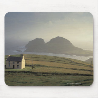 aerial view of a cottage on a hill by the sea mouse pad