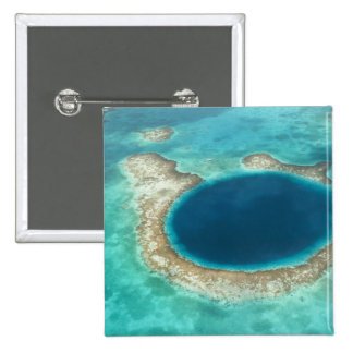 Aerial view of Blue Hole, sailboat anchored Button
